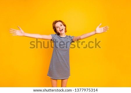 Close up photo beautiful amazing she her lady excited spread hands arms call friend hugging missed wear casual striped white blue t-shirt outfit clothes isolated yellow bright background #1377975314