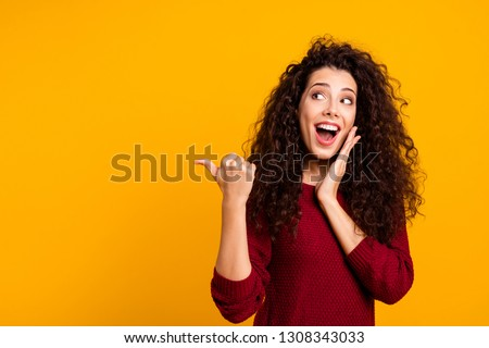 Close up photo beautiful cheerful amazing her she lady showing way one arm thumb other cheek wondered look empty space wearing red knitted sweater pullover clothes outfit isolated yellow background