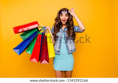 Close up photo beautiful her she lady yell scream shout new staff shopping spree excited big choice choose wear specs blue teal green short dress jeans denim jacket clothes isolated yellow background ストックフォト ©
