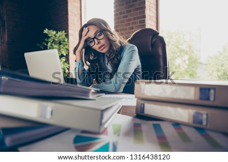 Close up photo beautiful she her business lady tired of bookkeeping running time last minutes seconds until boss chief come back mess papers hold head unwell sit office chair wearing formal wear suit