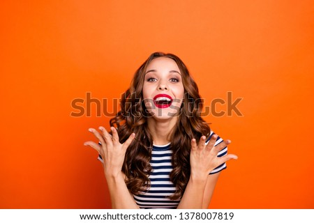 Close up photo beautiful she her lady glossy red lipstick hold arms hands air celebrating fame astonished celebrity wear casual striped white blue t-shirt clothes isolated orange bright background