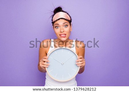 Close up photo beautiful she her lady hold arms hands round circle wall watch ten o'clock  just woke up miss work oh no bite lip wear sleeping mask white tank-top isolated violet purple background