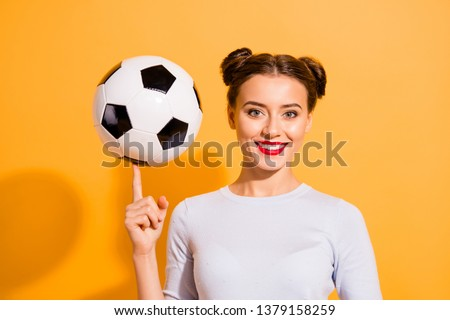 Close up photo beautiful she her lady pretty hairdo hold wind ball on finger training trick skillful talented tv show sportive sporty lifestyle wear casual white pullover isolated yellow background