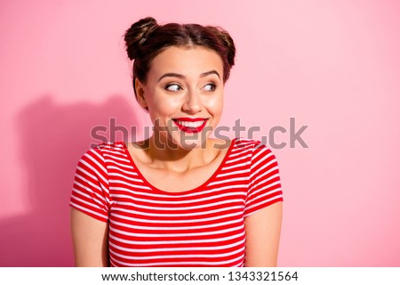 Close up photo beautiful she her lady pretty two buns pomade lips look up empty space toothy show white teeth sly know secret giggling wear casual striped red white t-shirt isolated pink background Photo stock ©