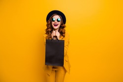 Close up photo beautiful she her lady very glad black friday laughter carry packs perfect look buy buyer birthday sale discount wear specs formal-wear costume suit isolated yellow bright background