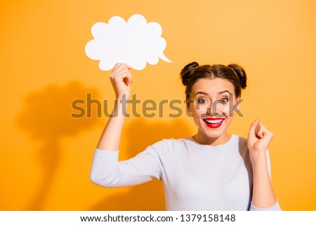 Close up photo cute beautiful she her lady pretty hairdo two buns hand arm hold paper answer invitation prom romantic date yes yeah wear casual white pullover clothes isolated yellow background