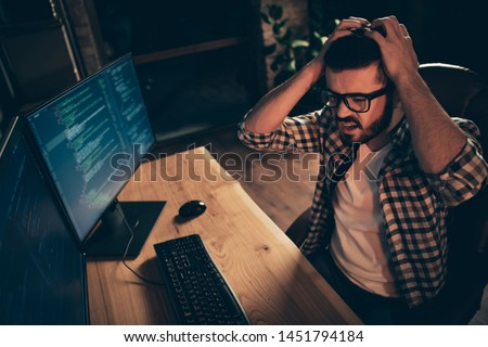 Close up photo handsome epic fail he him his guy crash code error system linux windows coder typing php css keyboard development outsource IT monitors table office wear specs formalwear plaid shirt