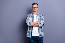 Close up photo intelligent he him his guy arms crossed cool reliable manager not smile self-confident self-assured person wear specs casual jeans denim plaid checkered shirt isolated grey background
