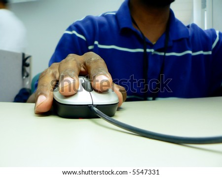 close up photo of a african american workers' hand on a computer mouse while sitting at his desk