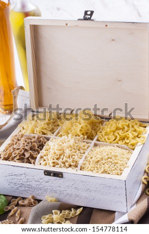 Close up photo of a noodles in a white box on a brown dish cloth and bright background.