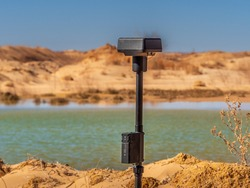 Close up photo of a Real Time Kinematic unit at an active sand mining operation. This ground station device communicates with the RTK drone, constantly verifying position data to ensure map accuracy.