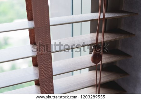 Close up photo of a wooden shutters blinds (Venetian blinds) with its rope #1203289555