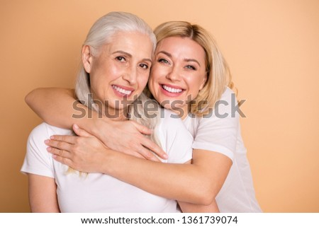 Close up photo of attractive cute ladies wavy curly hairdo leisure lifestyle show trust cuddle feel glad nice excited rejoice isolated wear trendy stylish clothing on pastel background