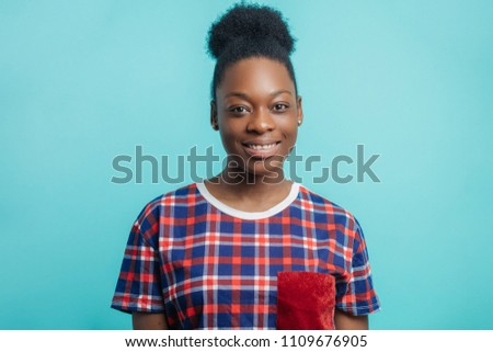 close up photo of beautiful African hardworking housewife with candid smile. african girl in stylisg funny T-shirt in happy mood as she has done her duties #1109676905