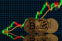 Close up photo of bitcoin litecoin and etherium cryptocurrency standing over the background with digital candle graph going up