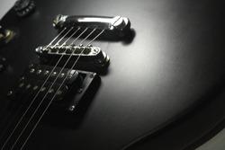 Close up photo of black matte electric guitar