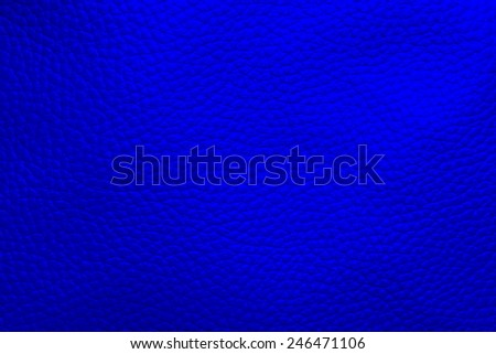 Close up photo of blue  color filtered leather surface texture style represent the surface background.