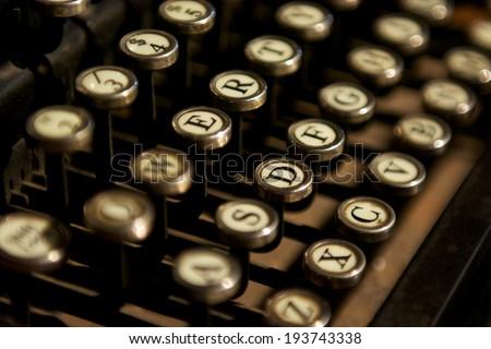 Close up photo of bronze vintage typewriter keys