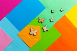 Close up photo of bubutttterflies silhouettes on varicoloured colorful paper background. Top view, spring and various holidays and events concept