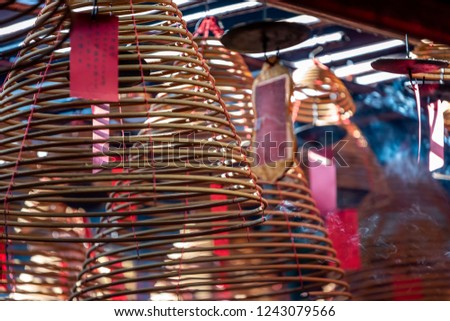 Close up photo of burning spiral candles in Man Mo Temple