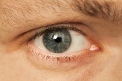 Close up photo of Caucasian man gray eye