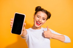 Close up photo of charming beautiful attractive lady taking photo offering suggesting advising product raising her thumb up dressed up white sweater isolated over vivid background