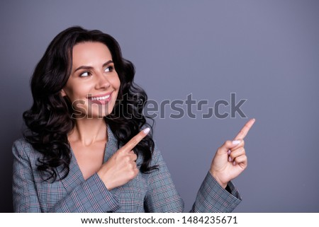 Close up photo of charming freelancer with wavy hair looking following adverts promo wearing stylish jacket blazer isolated over grey background
