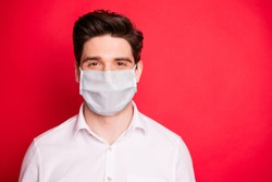 Close up photo of charming person stay home covid-19 quarantine wearing white medical fabric mask shirt isolated over red background