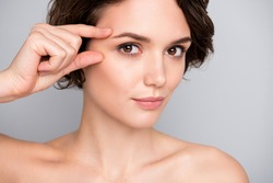 Close up photo of charming pretty gorgeous girl touch finger eyes look in mirror plastic surgery for soft ideal perfect skin effect she tried isolated over gray color background