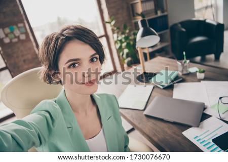 Close up photo of confident home working girl marketer ceo agent make selfie recording startup development seminar wear blazer jacket sit armchair in workstation