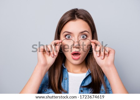 Close up photo of crazy astonished girl touch specs cant believe discount novelty wear casual style outfit isolated over gray color background Photo stock ©