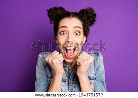 Close up photo of crazy funny funky youth lucky girl hear wonderful news about her award contest victory scream wow omg raise fists wear stylish trendy clothing over purple color background