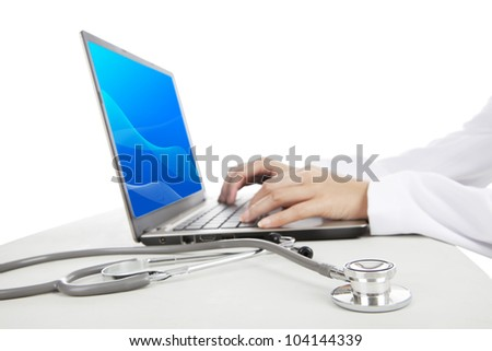 Close-up photo of doctor working on laptop. Shot in studio isolated on white
