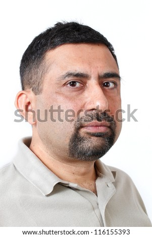 Close-up photo of face of an handsome indian man having cautious and suspicious look. The person can also represent expressions like being analytical, careful, nosy, jealous, serious, non-cooperative