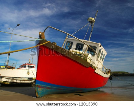 close up photo of fishing trawler, beached at Youghal, Co.Cork, during low tide - stock photo