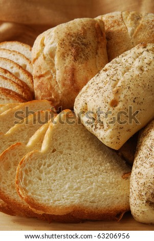 Close up photo of fresh artisan breads on a cutting board