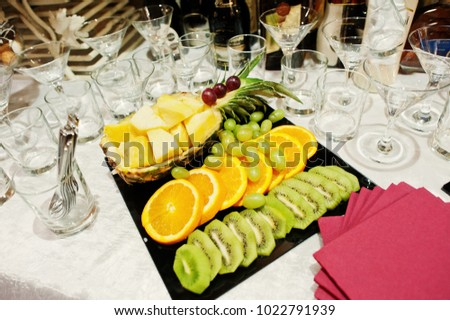 Close-up photo of fruits and alcohol on wedding banquet. #1022791939
