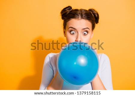 Close up photo of funky childish cheerful lady impressed by size of ballon for festivals carnivals celebration anniversary. Dressed in white cotton outfit isolated over vibrant background Сток-фото ©