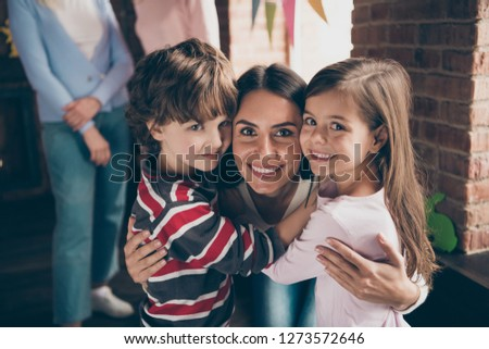 Close up photo of gathered relatives in decorated home house aunt cuddle to little girl boy children nephew niece looking gladly on camera missed little kids #1273572646