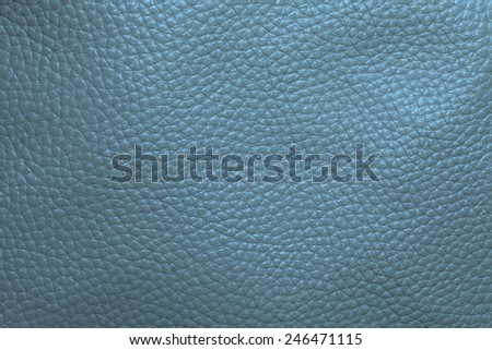 Close up photo of green  color filtered leather surface texture style represent the surface background.