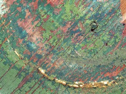 close up photo of green painted distressed wood of a vintage table
