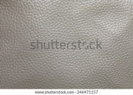 Close up photo of grey color filtered leather surface texture style represent the surface background.