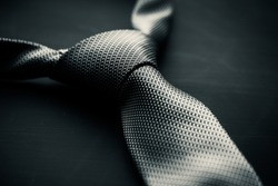 Close-up photo of grey men's tie