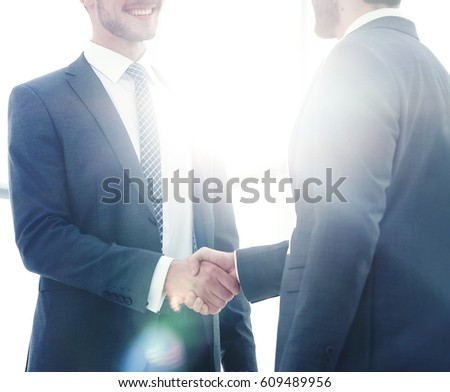 Close-up photo of handshake of two successful businessmen #609489956