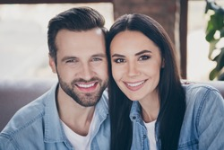 Close up photo of idyllic passionate loving family woman man enjoy spend quarantine together toothy smile wear denim jeans shirt in house room apartment indoors