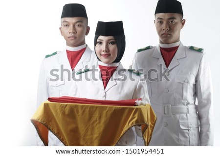 Close up photo of Indonesian National Flag Hoisting Troop carrying a yellow tray. National Paskibraka Council isolated