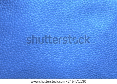 Close up photo of light blue color filtered leather surface texture style represent the surface background.