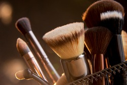 Close up photo of Makeup brushes with Bokeh