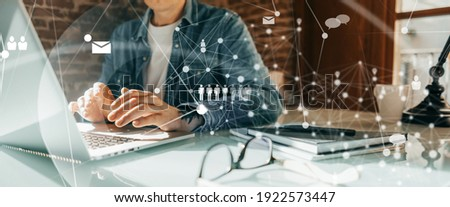 Close-up photo of male hands with laptop. Man working remotely at home. Concept of networking or remote work. Global business network.