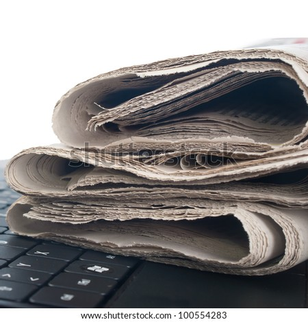 close up photo of newspaper on the keyboard